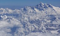 (FILES) In this file photo taken on April 27, 2019, an aerial view of Mount Everest (centre R) is pictured on a flight from Nepal to Bhutan. - Three more climbers have died on Everest, expedition organisers and officials said on May 24, taking the toll from a deadly week on the overcrowded world's highest peak to seven. (Photo by Sarah LAI / AFP)