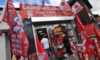 A shop sells Liverpool merchandise for the upcoming Champions League final in Liverpool on May 28, 2019. Liverpool will play Tottenham on June 1 in the final. (Photo by Anthony Devlin / AFP)
