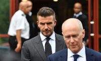 Former England international footballer David Beckham (C) leaves Bromley Magistrates Court in Bromley, south-east of London on May 9, 2019, after being disqualifeid from driving for six months for driving while using a mobile phone. (Photo by Daniel LEAL-OLIVAS / AFP)