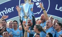 Brighton (United Kingdom), 12/05/2019.- Manchester City manager Pep Guardiola lifts the trophy after the English Premier League match between Brighton and Hove Albion and Manchester City, Brighton, Britain, 12 May 2019. Manchester City won 4-1 and won the Premier League title. (Reino Unido) EFE/EPA/JAMES BOARDMAN EDITORIAL USE ONLY. No use with unauthorized audio, video, data, fixture lists, club/league logos or 'live' services. Online in-match use limited to 120 images, no video emulation. No use in betting, games or single club/league/player publications.