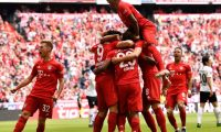 Munich (Germany), 18/05/2019.- Bayern players celebrate their opening goal during the German Bundesliga soccer match between FC Bayern Munich and Eintracht Frankfurt in Munich, Germany, 18 May 2019. (Alemania) EFE/EPA/LUKAS BARTH-TUTTAS CONDITIONS - ATTENTION: The DFL regulations prohibit any use of photographs as image sequences and/or quasi-video.
