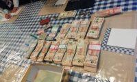 Berny Driceth Santizo Gramajo escondía en su vivienda Q103 mil 256.50 y US$ 1 mil 463. (Foto Prensa Libre: PNC)