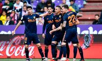 Valencia's Spanish forward Rodrigo Moreno (2R) celebrates  with teammates after scoring during the Spanish League football match between Real Valladolid and Valencia at the Jose Zorrilla stadium in Valladolid on May 18, 2019. (Photo by OSCAR DEL POZO / AFP)