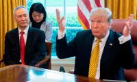 "(FILES) In this file photo taken on April 4, 2019, US President Donald Trump (R) speaks during a trade meeting with China's Vice Premier Liu He (L) in the Oval Office at the White House in Washington, DC. - Trump urged patience in trade talks with China on May 10, 2019, saying there is ""no need to rush"", after the US enacted a steep hike in tariffs on Chinese products and Beijing vowed to hit back. Locked in a trade dispute for more than a year, officials from the world's two biggest economies returned to the bargaining table late Thursday, led by Chinese Vice Premier Liu He, US Trade Representative Robert Lighthizer and US Treasury Secretary Steven Mnuchin. (Photo by Jim WATSON / AFP)"