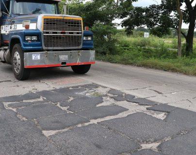 La autopista Escuintla-Puerto Quetzal tiene daños. (Foto Prensa Libre: Hemeroteca PL)