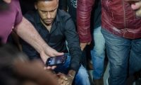 Brazil's star striker Neymar arrives using a wheelchair to the Police Station to give a statement for posting intimate WhatsApp messages with Najila Trindade Mendes de Souza, who has accused of rape, on social media, at the Internet Crime Special Police Unit in Rio de Janeiro, Brazil on June 6, 2019. (Photo by Mauro Pimentel / AFP)