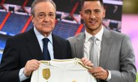 Belgian footballer Eden Hazard (R) and Real Madrid's president Florentino Perez hold the midfielder's new jersey during his official presentation as new player of the Spanish club at the Santiago Bernabeu stadium in Madrid on June 13, 2019. (Photo by GABRIEL BOUYS / AFP)