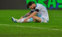 Argentina's Lionel Messi sits on the ground after being fouled during their Copa America football tournament group match against Paraguay at the Mineirao Stadium in Belo Horizonte, Brazil, on June 19, 2019. (Photo by Luis ACOSTA / AFP)
