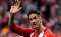 (FILES) In this file photo taken on May 20, 2018 Atletico Madrid's Spanish forward Fernando Torres waves at fans during a tribute at the end of the Spanish league football match between Club Atletico de Madrid and SD Eibar at the Wanda Metropolitano stadium in Madrid on May 20, 2018. - Fernando Torres, the former Atletico Madrid, Liverpool and Chelsea forward who won the World Cup with Spain, announced on June 21, 2019 he was retiring. (Photo by GABRIEL BOUYS / AFP)