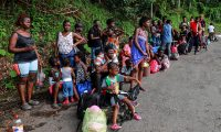 Migrants of different nationalities queue outside the Mexican National Institute of Migration in Tapachula, Chiapas State, Mexico, near the Guatemalan border, on June 27, 2019. - Guatemala is a starting and transit point for migrant caravans that have since last year embarked for Mexico and the US border, angering US President Donald Trump and inflaming tensions between Washington and its southern neighbours. Most of the migrants are from Central America, but others have joined the caravans from other countries on the continent such as Colombia and Cuba, and even as far afield as Africa. (Photo by QUETZALLI BLANCO / AFP)