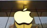 (FILES) In this file photo taken on May 10, 2019 an Apple logo is displayed at store in Shanghai. - Apple is seen as a prime target for retaliation over US moves against the Chinese tech giant Huawei, but the roots planted by the company in China should help it weather the storm, analysts say. (Photo by HECTOR RETAMAL / AFP)