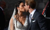 Real Madrid's Spanish football player Sergio Ramos and his wife Pilar Rubio kiss as they leave the Cathedral of Seville on June 15, 2019 after their wedding. (Photo by CRISTINA QUICLER / AFP)
