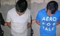 Dos supuestos coyotes capturados en Huehuetenango. (Foto Prensa Libre: PNC).