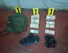 Parte del dinero decomisado en La Democracia, Huehuetenango. (Foto Prensa Libre: PNC).