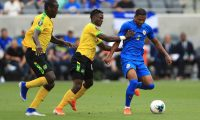 LOS ANGELES, CALIFORNIA - JUNE 25: Michael Maria #6 of Curacao controls the ball past the defense of Andre Lewis #4 and Je-Vaughn Watson #15 of Jamaica during the second half of the Jamaica v Curacao: Group C - 2019 CONCACAF Gold Cup match at Banc of California Stadium on June 25, 2019 in Los Angeles, California.   Sean M. Haffey/Getty Images/AFP == FOR NEWSPAPERS, INTERNET, TELCOS & TELEVISION USE ONLY ==