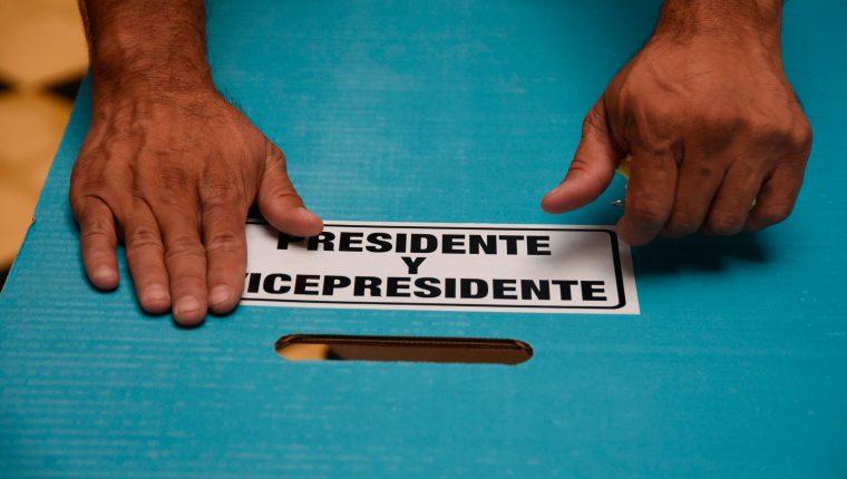 Los migrantes únicamente podían votar por candidato presidencial y vicepresidencial (Foto Prensa Libre: AFP)