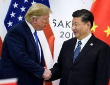 Donald Trump y Xi Jinping, durante el encuentro del G20 en Osaka, Japón. (Foto Prensa Libre: AFP)