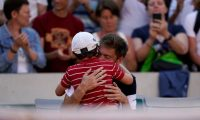 France's Nicolas Mahut hugs his son at the end of his men's singles third round match against Argentina's Leonardo Mayer on day six of The Roland Garros 2019 French Open tennis tournament in Paris on May 31, 2019. (Photo by Kenzo TRIBOUILLARD / AFP)