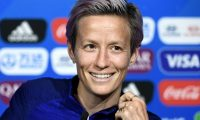 United States' captain Megan Rapinoe smiles during a press conference at the Groupama stadium in Decines-Charpieu on July 6, 2019, during the France 2019 football Women's World Cup. - USA will face The Netherlands for the final of the France 2019 Women's World Cup on July 7, 2019. (Photo by FRANCK FIFE / AFP)
