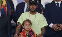 Brazilian injured footballer Neymar and his son are seen on the stands before the Copa America football tournament final match between Brazil and Peru at Maracana Stadium in Rio de Janeiro, Brazil, on July 7, 2019. (Photo by Juan MABROMATA / AFP)
