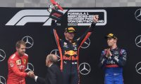 (L-R) Second placed Ferrari's German driver Sebastian Vettel, winner Red Bull's Dutch driver Max Verstappen and third placed Toro Rosso's Russian driver Daniil Kvyat celebrate on the podium after the German Formula One Grand Prix at the Hockenheim racing circuit on July 28, 2019 in Hockenheim, southern Germany. (Photo by Christof STACHE / AFP)