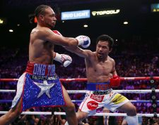 LAS VEGAS, NEVADA - JULY 20: Manny Pacquiao (R) connects with a punch on Keith Thurman during their WBA welterweight title fight at MGM Grand Garden Arena on July 20, 2019 in Las Vegas, Nevada.   Steve Marcus/Getty Images/AFP == FOR NEWSPAPERS, INTERNET, TELCOS & TELEVISION USE ONLY ==