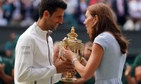 Wimbledon (United Kingdom), 14/07/2019.- Novak Djokovic of Serbia receives the championship trophy from Catherine the Duchess of Cambridge after defeating Roger Federer of Switzerland in the men's final of the Wimbledon Championships at the All England Lawn Tennis Club, in London, Britain, 14 July 2019. (Tenis, Duque Duquesa Cambridge, Suiza, Reino Unido, Londres) EFE/EPA/NIC BOTHMA EDITORIAL USE ONLY/NO COMMERCIAL SALES