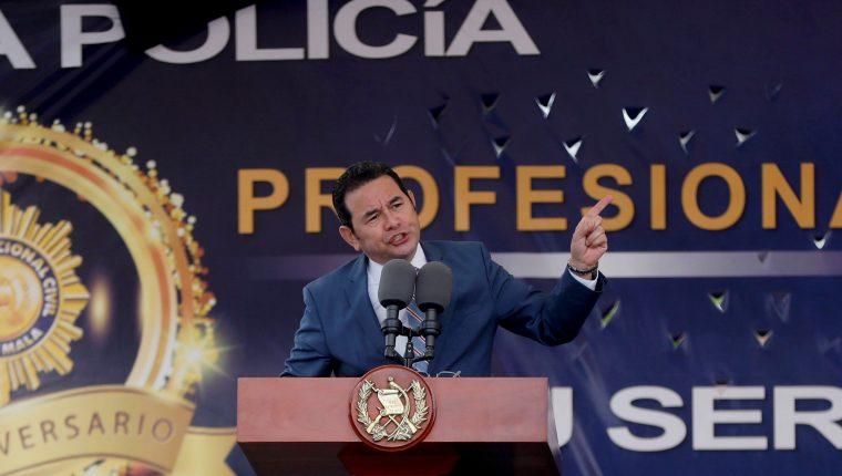 """El presidente Jimmy Morales defiende la decisión de aceptar ser """"tercer país seguro"""". (Foto Prensa Libre: EFE)"""