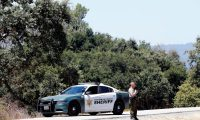 Gilroy (United States), 29/07/2019.- A San Benito County Sheriff guards along a creek near the north side of Christmas Hill Park, where the Gilroy Garlic Festival was held in Gilroy, California, USA, 29 July 2019. A gunman fired upon patrons killing three and injuring 15 people at the popular annual event. Police killed the suspect, and a possible suspect is at large. Santino William Legan has been identified as the 19-year-old suspect from Gilroy. (Incendio, Estados Unidos) EFE/EPA/JOHN G. MABANGLO