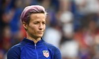 United States' forward Megan Rapinoe looks on during warm up prior to the  France 2019 Women's World Cup semi-final football match between England and USA, on July 2, 2019, at the Lyon Satdium in Decines-Charpieu, central-eastern France. (Photo by FRANCK FIFE / AFP)