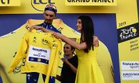 France's Julian Alaphilippe wearing his overall leader's yellow jersey celebrates on the podium after the fourth stage of the 106th edition of the Tour de France cycling race between Reims and Nancy, in Nancy, eastern France, on July 9, 2019. (Photo by JEFF PACHOUD / AFP)