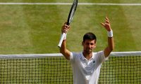 Serbia's Novak Djokovic celebrates beating Spain's Roberto Bautista Agut during their men's singles semi-final match on day 11 of the 2019 Wimbledon Championships at The All England Lawn Tennis Club in Wimbledon, southwest London, on July 12, 2019. (Photo by Tim Ireland / POOL / AFP) / RESTRICTED TO EDITORIAL USE