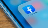 (FILES) In this file photo taken on July 10, 2019, the Facebook app is seen in this photo illustration in Washington, DC. - Facebook acknowledged July 23, 2019, that a flaw in its Messenger Kids service allowed children get into group chats with people who were not approved by their parents. The leading social network said it has been shutting down the group chats involved and notifying thousands of parents that their children many have unintentionally connected with strangers. (Photo by Alastair Pike / AFP)