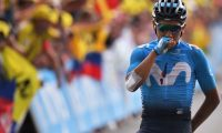Colombia's Nairo Quintana celebrates as he wins on the finish line of the eighteenth stage of the 106th edition of the Tour de France cycling race between Embrun and Valloire, in Valloire, on July 25, 2019. (Photo by Marco Bertorello / AFP)