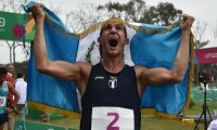Guatemala's Charles Fernandez celebrates after winning the men's modern pentathlon event during the Lima 2019 Pan-American Games in Lima, on July 28, 2019. (Photo by CRIS BOURONCLE / AFP)