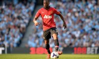 "(FILES) In this file photo taken on September 22, 2013 then Manchester United's French defender Patrice Evra runs with the ball during an English Premier League football match in Manchester. - French former international Patrice Evra, 38, who played in Monaco, Manchester, Marseille, Juventus and West Ham, announced on July 29, 2019 his ""carrier as a player is officially over"" in the Italian Sport newspaper ""Gazzetta dello Sport."" (Photo by Paul ELLIS / AFP)"