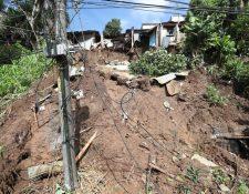 Dos viviendas fueron dañadas por el deslizamiento en el asentamiento Nuestro Señor de Esquipulas, El Limón, en zona 18. (Foto Prensa Libre: Érick Ávila)