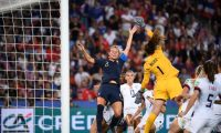 France's midfielder Amandine Henry (L) jumps for the ball with United States' goalkeeper Alyssa Naeher during the France 2019 Women's World Cup quarter-final football match between France and United States, on June 28, 2019, at the Parc des Princes stadium in Paris. (Photo by FRANCK FIFE / AFP)