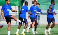 Barcelona's French forward Antoine Griezmann (C) runs with teammates during the football club's first pre-season training session at the Joan Gamper training ground in Sant Joan Despi near Barcelona on July 15, 2019. (Photo by LLUIS GENE / AFP)
