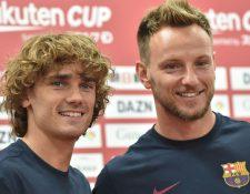 Griezmann e Ivan Rakitic hablaron del trabajo del Barcelona y del partido contra el Chelsea en Japón. (Foto Prensa Libre: AFP).