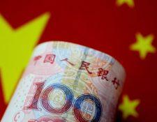 El Banco Popular de China ha dejado caer el yuan un 1,4% frente al dólar.