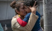 GUATEMALA CITY, GUATEMALA - AUGUST 22: A mother embraces her son after he and his father arrived on an ICE deportation flight from the U.S. on August 22, 2019 in Guatemala City, Guatemala. Under a new policy, ICE has expedited removal procedures for many Guatemalan families and adults arriving to the U.S.-Mexico border. The more streamlined approach replicates how DHS currently works with immigrant removals to Mexico, according to DHS.   John Moore/Getty Images/AFP == FOR NEWSPAPERS, INTERNET, TELCOS & TELEVISION USE ONLY ==
