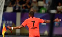 Paris Saint Germain's Kylian Mbappe celebrates after scoring against Sydney FC at Suzhou Olympic Sports Center Stadium during the International Super Cup in Suzhou, Jiangsu province on July 30, 2019. (Photo by HECTOR RETAMAL / AFP)