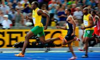 (FILES) In this file photo taken on August 16, 2009 Jamaica's Usain Bolt wins the men's 100m final race of the 2009 IAAF Athletics World Championships ahead of US Tyson Gay and Jamaica's Asafa Powell in Berlin. - Ten years ago Jamaican Usain Bolt set a world record of 9.58 seconds in winning the final of the men's 100m at the World Athletics Championships. (Photo by Fabrice COFFRINI / AFP)