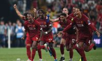 Liverpool's players celebrate winning the UEFA Super Cup 2019 football match between FC Liverpool and FC Chelsea at Besiktas Park Stadium in Istanbul on August 14, 2019. (Photo by Bulent Kilic / AFP)