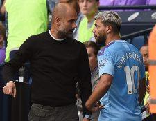 El técnico Pep Guardiola y Sergio 'el Kun' Agüero discutieron por la salida del jugador. (Foto Prensa Libre: EFE)