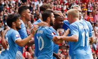Manchester City's English midfielder Raheem Sterling (3R) celebrates scoring the opening goal during the English FA Community Shield football match between Manchester City and Liverpool at Wembley Stadium in north London on August 4, 2019. (Photo by Adrian DENNIS / AFP) / NOT FOR MARKETING OR ADVERTISING USE / RESTRICTED TO EDITORIAL USE