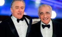 """(FILES) In this file photo taken on December 1, 2018 US actor Robert De Niro (L) and US film director Martin Scorsese (R), arrive at the Marrakech International Film festival in the city of Marrakesh - Netflix on July 31, 2019 unveiled the trailer for Martin Scorsese's long-awaited new film, """"The Irishman"""" -- a major project for the streaming giant featuring powerhouse Oscar winners Robert de Niro, Al Pacino and Joe Pesci, all digitally enhanced to look younger. The crime epic tells the story of powerful union leader Jimmy Hoffa (Pacino), crime boss Russell Bufalino (Pesci) and Frank """"The Irishman"""" Sheeran (De Niro), who claimed he killed more than 25 people on their orders. (Photo by FADEL SENNA / AFP)"""