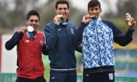 Guatemala's Charles Fernandez (C), Chile's Esteban Bustos (L), and Argentina's Sergio Villamayor pose on the podium of the men's modern pentathlon event with their gold, silver and bronze medals respectively, during the Lima 2019 Pan-American Games in Lima, on July 28, 2019. (Photo by CRIS BOURONCLE / AFP)