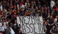 "Paris Saint-Germain's supporters hold a banner reading ""Neymar, buzz off!"" prior to the French L1 football match between Paris Saint-Germain (PSG) and Nimes Olympique on August 11, 2019 at the Parc des Princes stadium in Paris. (Photo by FRANCK FIFE / AFP)"